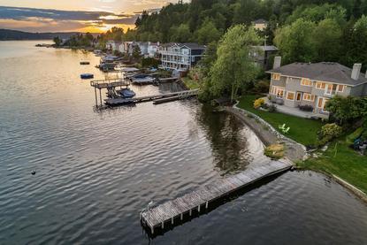 Live like royalty in this waterfront Lake Sammamish estate