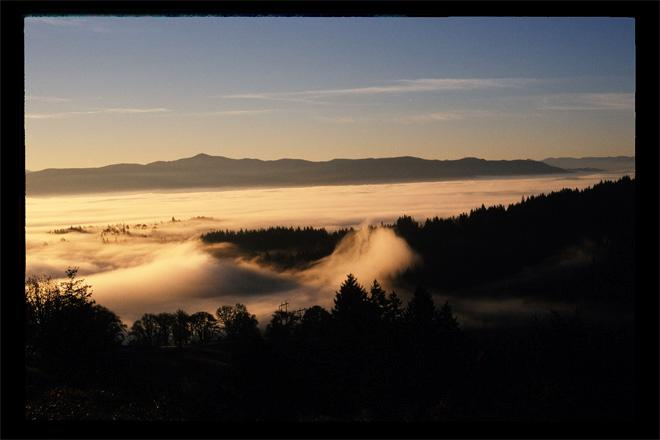 Unicorn and wave of fog hitting shores of hillsides east of Eugene at daybreak - (Photo: YouNews contributor: johnflinn)