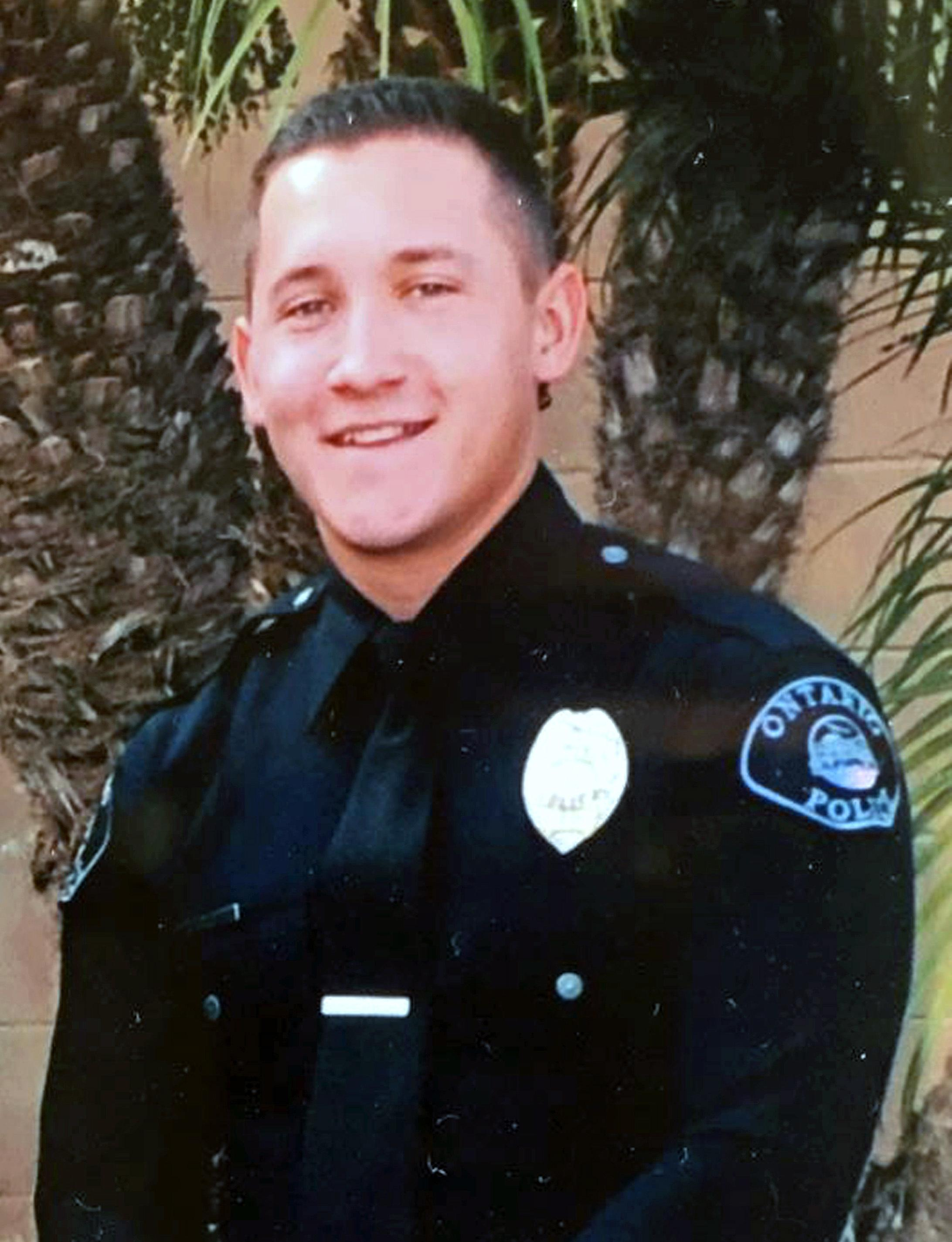 This undated photo provided by the Ontario Police Department shows Officer Michael Gracia. On Sunday, Oct. 1, 2017, Gracia was off duty when he was injured during a mass shooting at a concert in Las Vegas. (Ontario Police Department via AP)