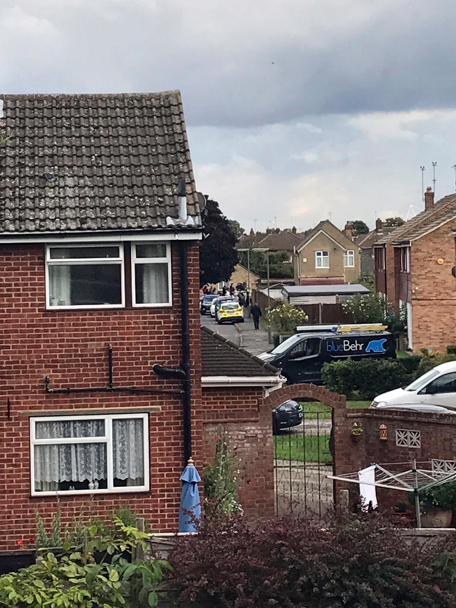 "In this photo provided by Steph Forsyth, police raid a property, in Sunbury-on-Thames, England, Saturday, Sept. 16, 2017.  British police made a ""significant"" arrest Saturday in the manhunt for suspects a day after the London subway was hit by a partially-exploded bomb and launched a heavily armed search of a home southwest of London. (Steph Forsyth via AP)"