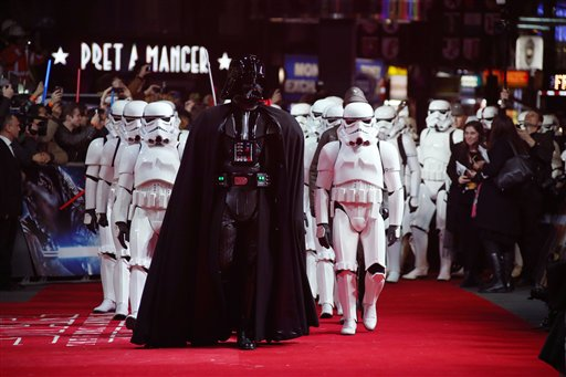 Actors dressed as Stormtroopers and Darth Vader arrive at the European premiere of the film 'Star Wars: The Force Awakens ' in London, Wednesday, Dec. 16, 2015. (Photo by Joel Ryan/Invision/AP)