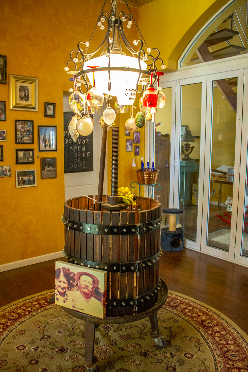 The foyer showcases a wine-themed lighting fixture made by Konnie surrounded by historic images and facts about the school's past. / Image: Katie Robinson, Cincinnati Refined // Published: 10.13.19