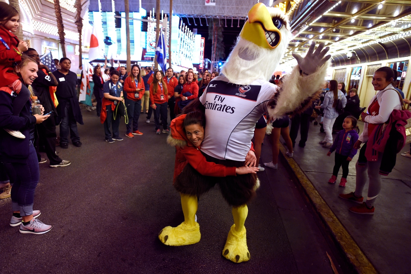 "A player from the Spanish national team pretends to tackle the US national team's mascot during the USA Sevens rugby ""Parade of Nations"" Thursday, March 3, 2017, at the Fremont Street Experience. CREDIT: Sam Morris/Las Vegas News Bureau"