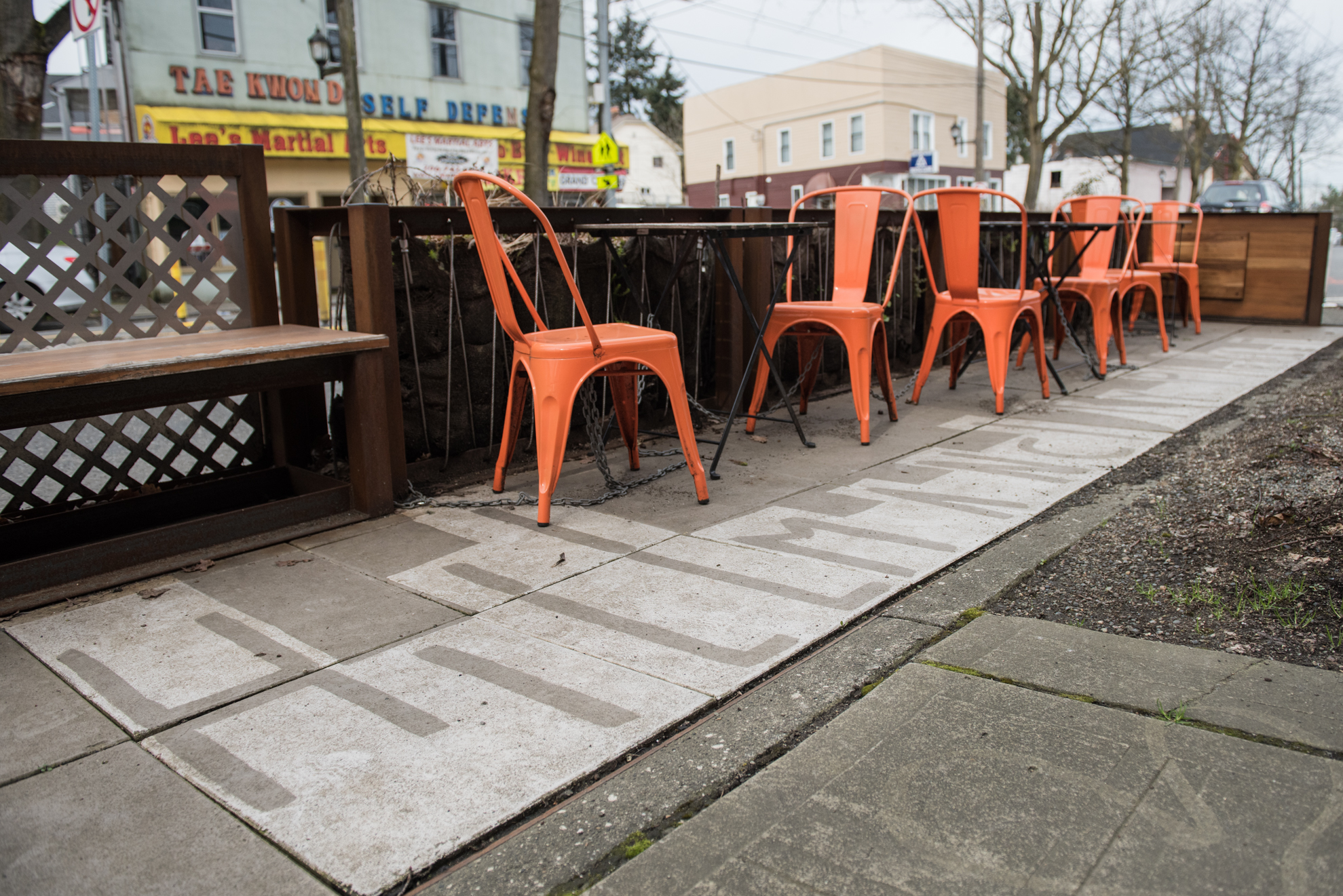 Hillman City Parklet: Outside Tin Umbrella Coffee Roasters in Hillman City bright orange chairs give a pop of color at this parklet. (Image: Natalia Dotto)