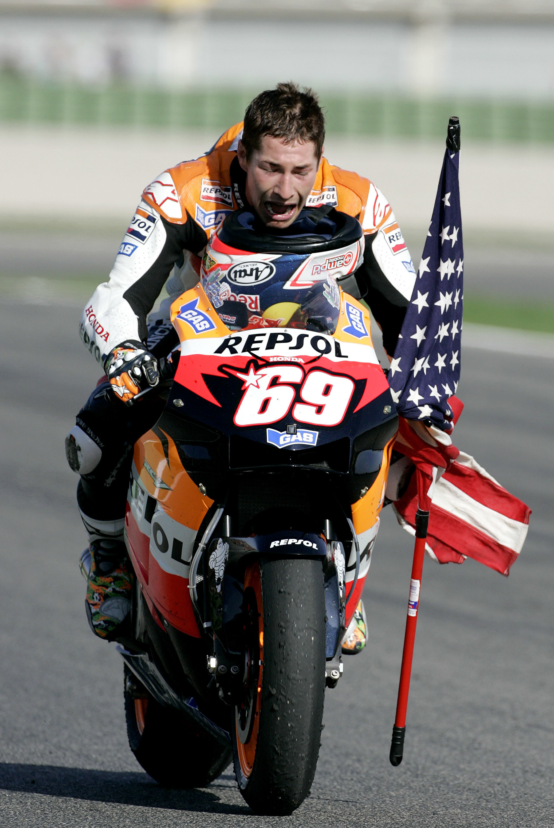 FILE - In this Sunday Oct. 29, 2006 file photo, United States Honda rider Nicky Hayden celebrates after winning the world Moto GP championship at the Cheste racetrack near Valencia, Spain. American motorcycle racer Nicky Hayden has been hit by a car while out training on his bicycle, Wednesday, May 17, 2017. The Superbike World Championship says the incident occurred along the Rimini coast, Italy, Wednesday.  The 35-year-old Hayden who won the MotoGP title in 2006 was transported to a local hospital for treatment. (AP Photo/Bernat Armangue, File)