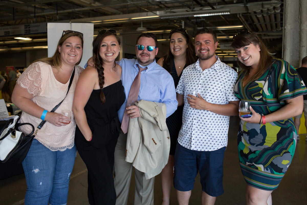 "Averyl Dunn, Jillian Zech, Dan Mooney, Alexa Goldstein, Nathan Cant and Chantelle Lusebrink celebrated at Wine Rocks last night at Pier 66 in Seattle. Wine Rocks is an annual not-for-profit gathering of local winemakers and craft brewers celebrating ""exceptional wine, unique distillates, outstanding beer, groovy tunes, savory fare and one heckuva backdrop."" (Image: Joshua Lewis / Seattle Refined)"