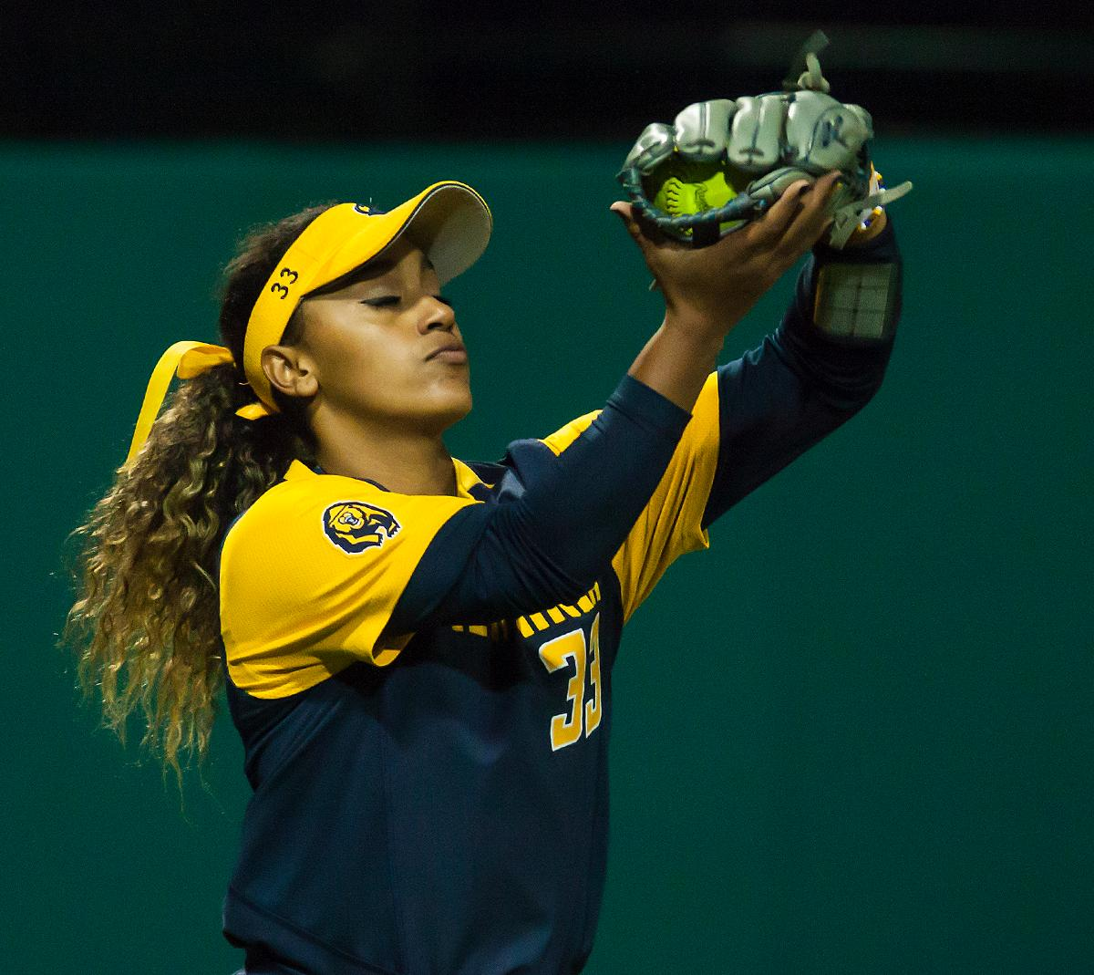 California outfielder Khala Taylor catches the ball before throwing towards the infield. In the first of a three game series the Oregon Ducks defeated the California Golden Bears five to one. Photo by Ben Lonergan, Oregon News Lab