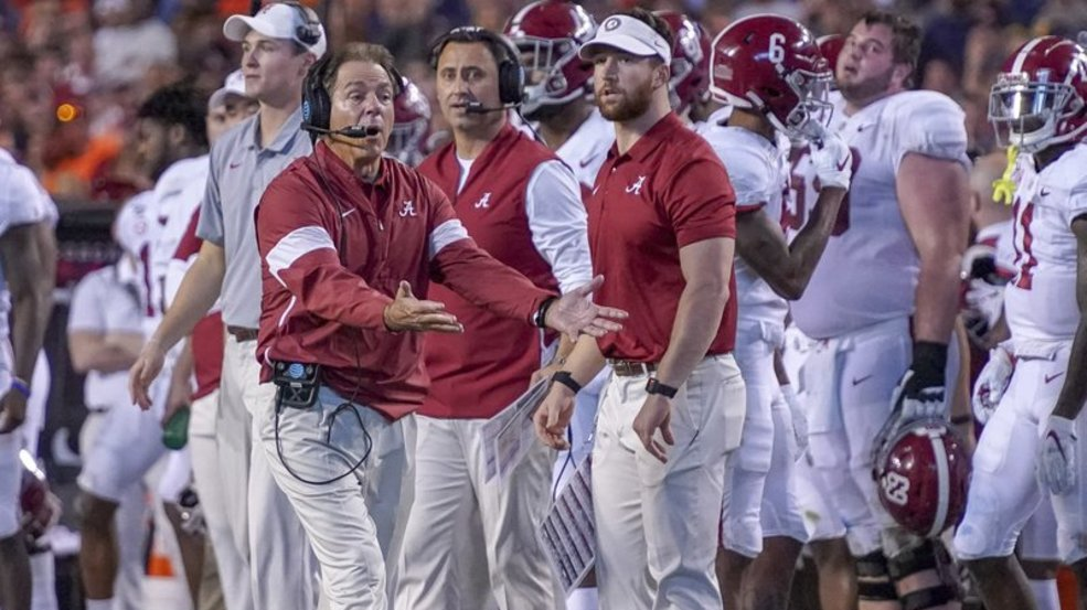 Alabama head coach Nick Saban disagrees with a call in the second half of an NCAA college football game against Auburn in Auburn, Ala., on Saturday, Nov. 30, 2019. (Chris Shimek/The Decatur Daily via AP)