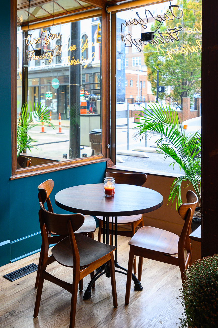 Seating was added in the front windows so patrons can enjoy the Japp's unique view up and down 12th and Main Streets while drinking cocktails.{ }/ Image: Phil Armstrong, Cincinnati Refined // Published: 10.25.19