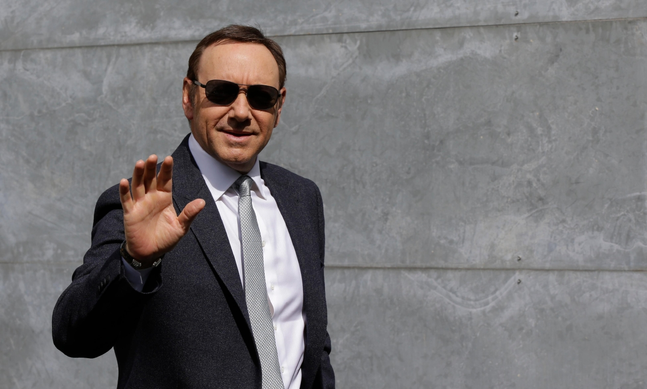 Actor Kevin Spacey waves as he arrives to attend the Giorgio Armani men's Spring-Summer 2016-2017 fashion show, that was presented in Milan, Italy, Tuesday, June 21, 2016. (AP Photo/Luca Bruno)