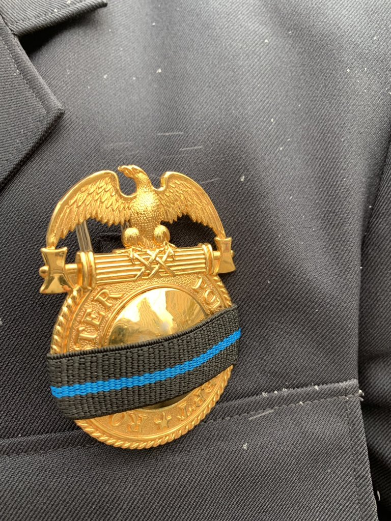Rochester Police officers wore black bands with a thin blue line over their badges at the memorial service for Rochester Police Officer Manuel 'Manny' Ortiz. The ceremony was held at the Joseph A. Floreano Rochester Riverside Convention Center on Friday, November 8, 2019. (WHAM photo)