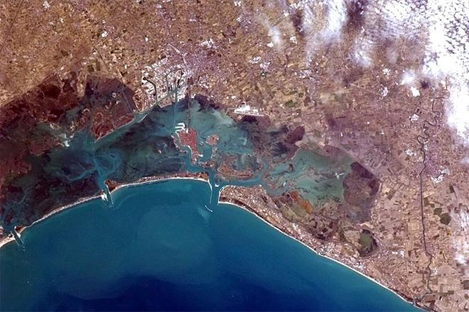 Venice, Italy - the red roofs and white docks of the famed island city are visible from orb (Photo & Caption: Chris Hadfield/NASA) it.