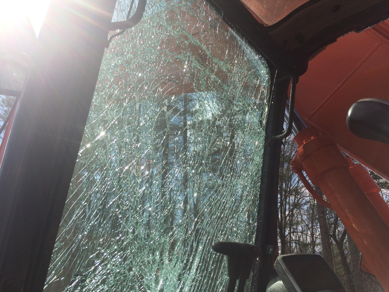 Shattered glass in track hoe. Photo credit WLOS