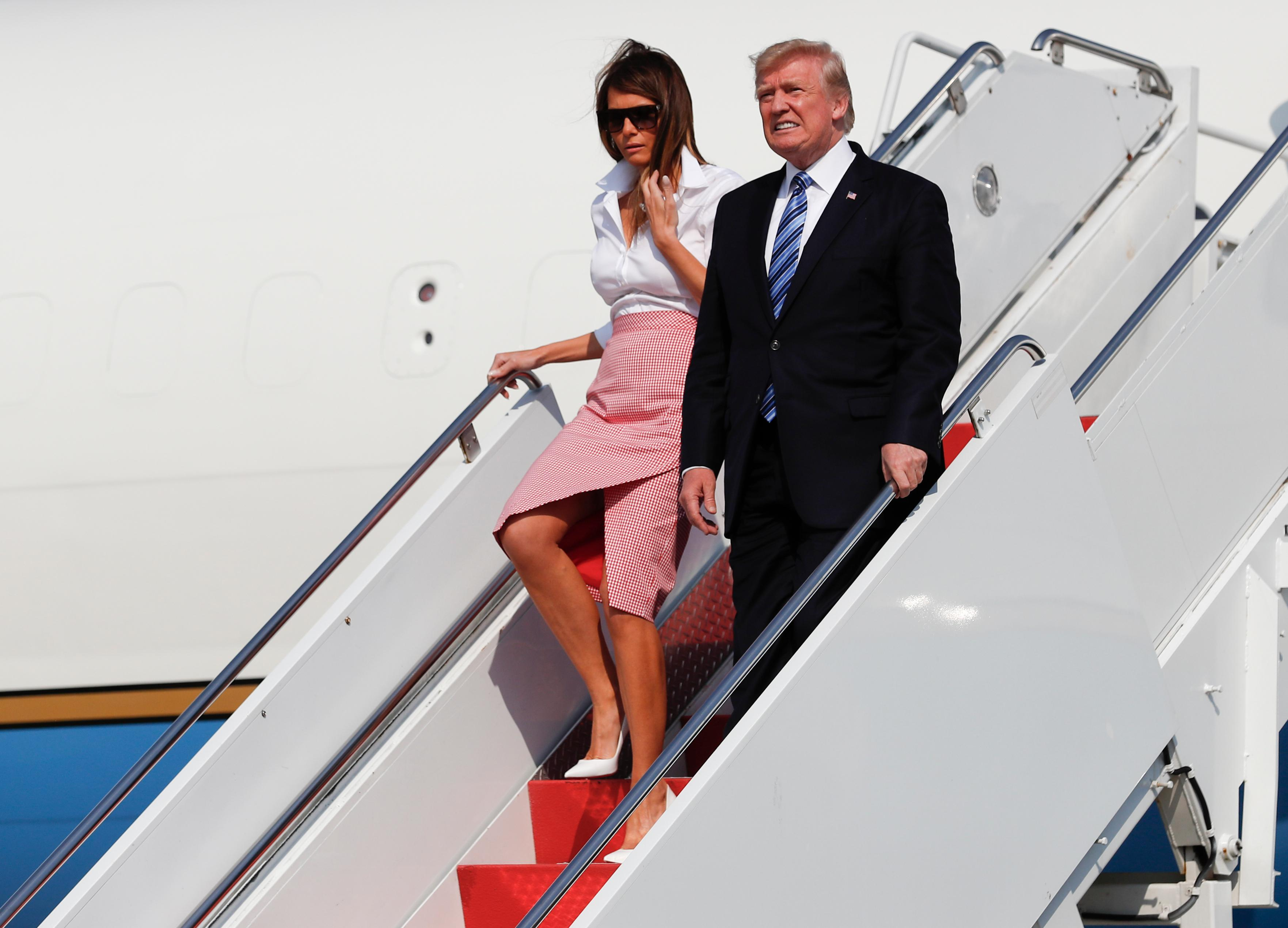 President Donald Trump and first lady Melania Trump arrive on Air Force One at Morristown Municipal Airport, in Morristown, N.J., Friday, June 30, 2017, en route to Trump National Golf Club in Bedminster, N.J.. (AP Photo/Carolyn Kaster)