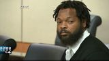 Michael Bennett surrenders to face felony charge; lawyer says he's innocent