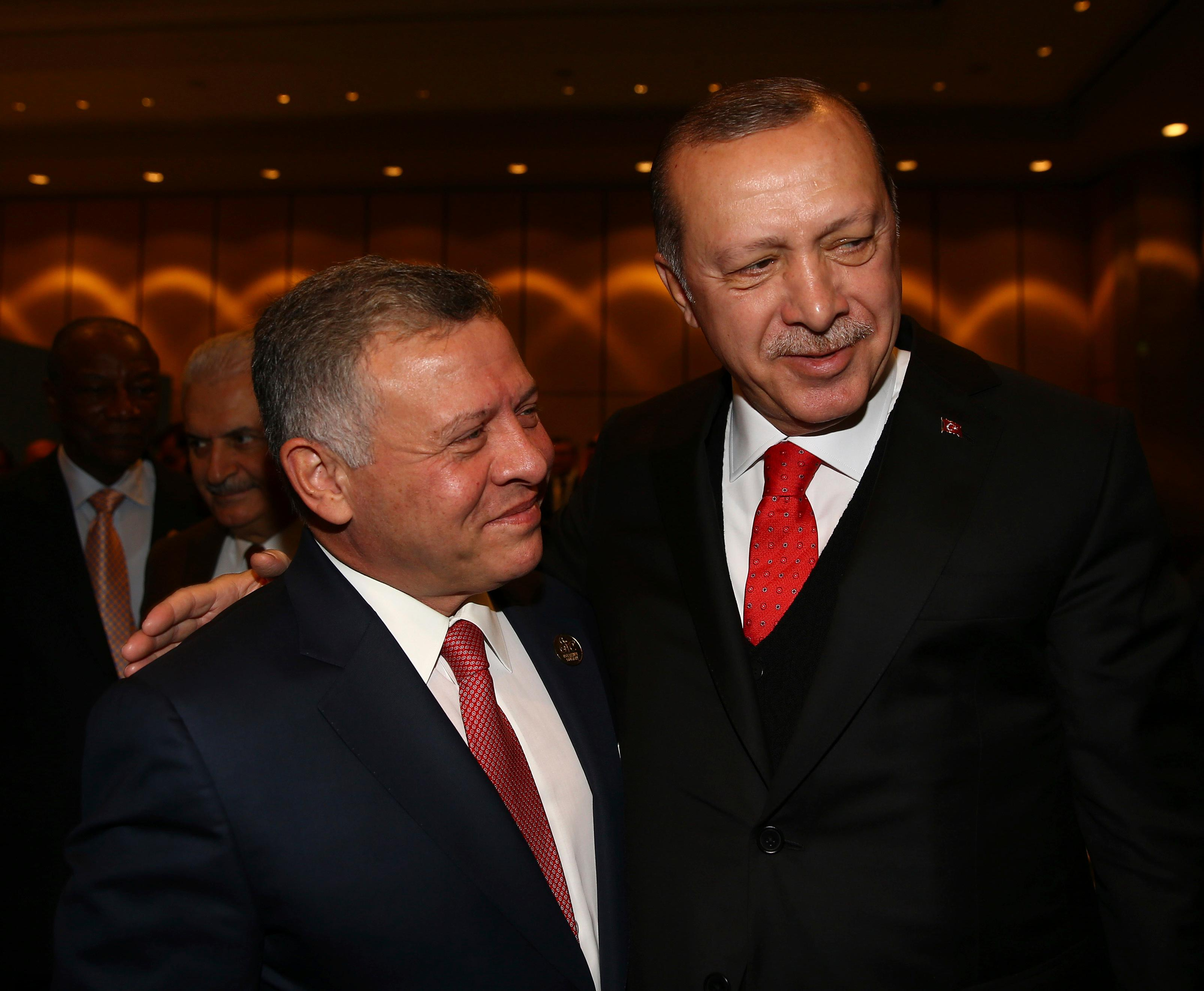 "Turkey's President Recep Tayyip Erdogan, right, welcomes Jordan's King Abdullah II, left, prior to the opening session of the Organisation of Islamic Cooperation Extraordinary Summit in Istanbul, Wednesday, Dec. 13, 2017. Leaders and high-ranking officials of Muslim countries met in Istanbul to discuss the U.S. recognition of Jerusalem as Israel's capital. Erdogan_ term president of OIC, the umbrella organisation of 57-members, has been vehemently critical of the U.S. move and said the leaders would relay a ""strong message."" (Kayhan Ozer/Pool Photo via AP)"
