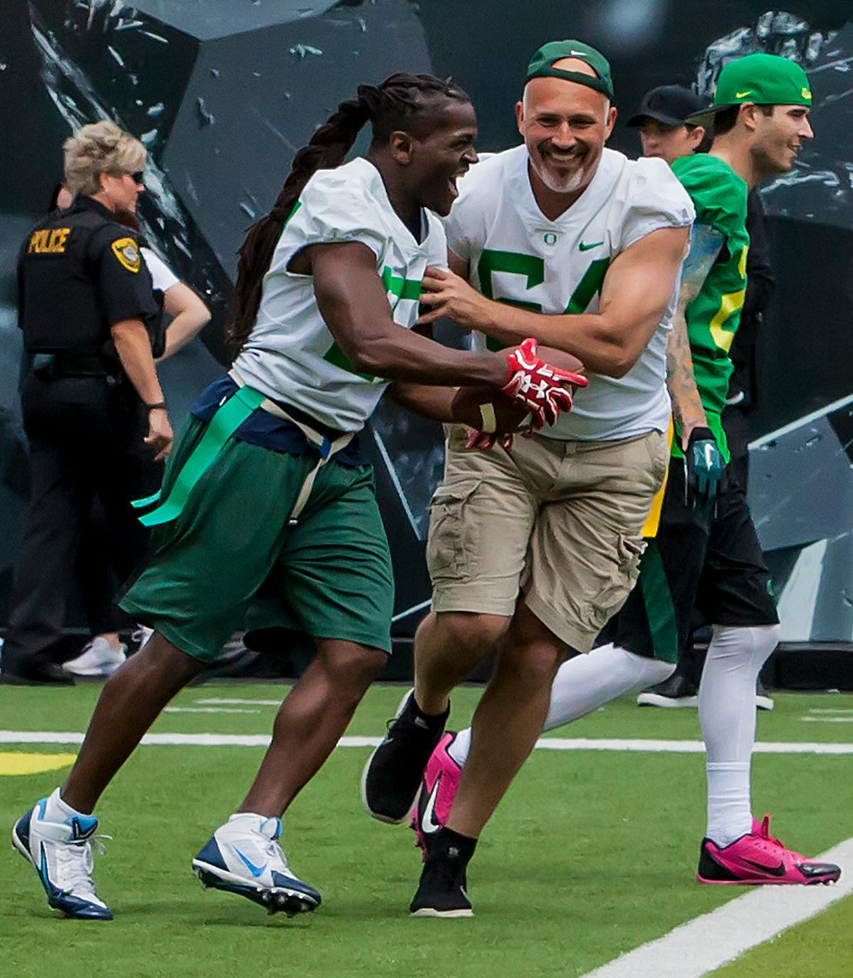 University of Oregon football alumni participate in a flag football game during halftime.The 2017 Oregon Ducks Spring Game provided fans their first glimpse at the team under new Head Coach Willie Taggart's direction. Team Free defeated Team Brave 34-11 on a sunny dat at Autzen Stadium in Eugene, Oregon. Photo by Ben Lonergan, Oregon News Lab