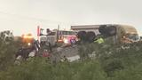 Driver trapped after tractor trailer crashes down embankment