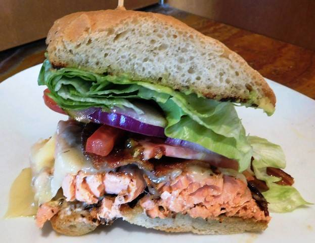 Bronzed Alaskan Salmon Club  John Howie Steak, located in downtown Bellevue, brings major sandwich game. Every day the steakhouse features a unique and new sandwich called they call #SandwichOfTheDay. Enjoy the gallery! These are just a few of the daily sandwiches that look absolutely mind-blowing. To see the current Sandwich of the Day, check out John Howie Steak's Facebook page. (Image courtesy of John Howie Steak)