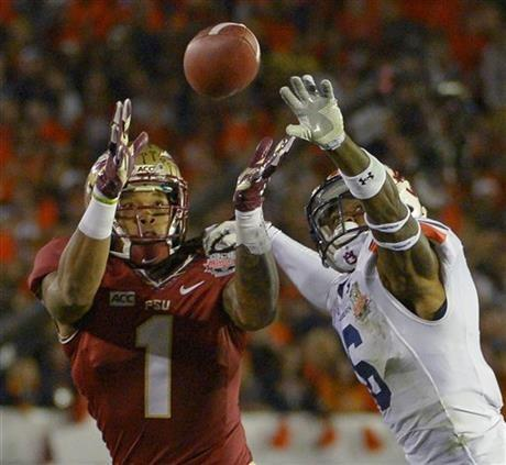 Auburn's Jonathon Mincy (6) breaks up a pass intended for Florida State's Giorgio Newberry during the first half of the NCAA BCS National Championship college football game Monday, Jan. 6, 2014, in Pasadena, Calif.