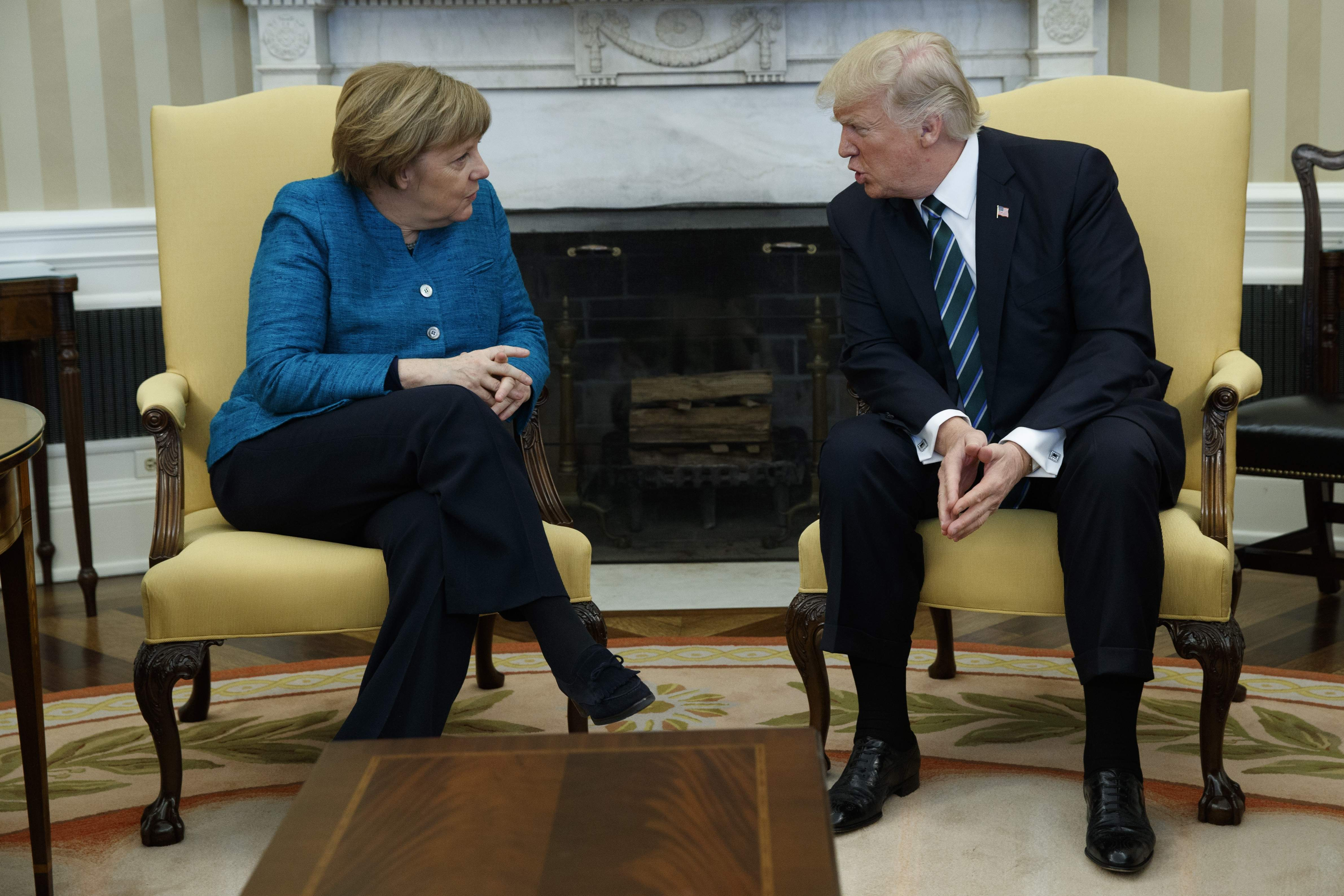 DAY 57 - in this March 17, 2017, file photo, President Donald Trump meets with German Chancellor Angela Merkel in the Oval Office of the White House in Washington. (AP Photo/Evan Vucci, File)
