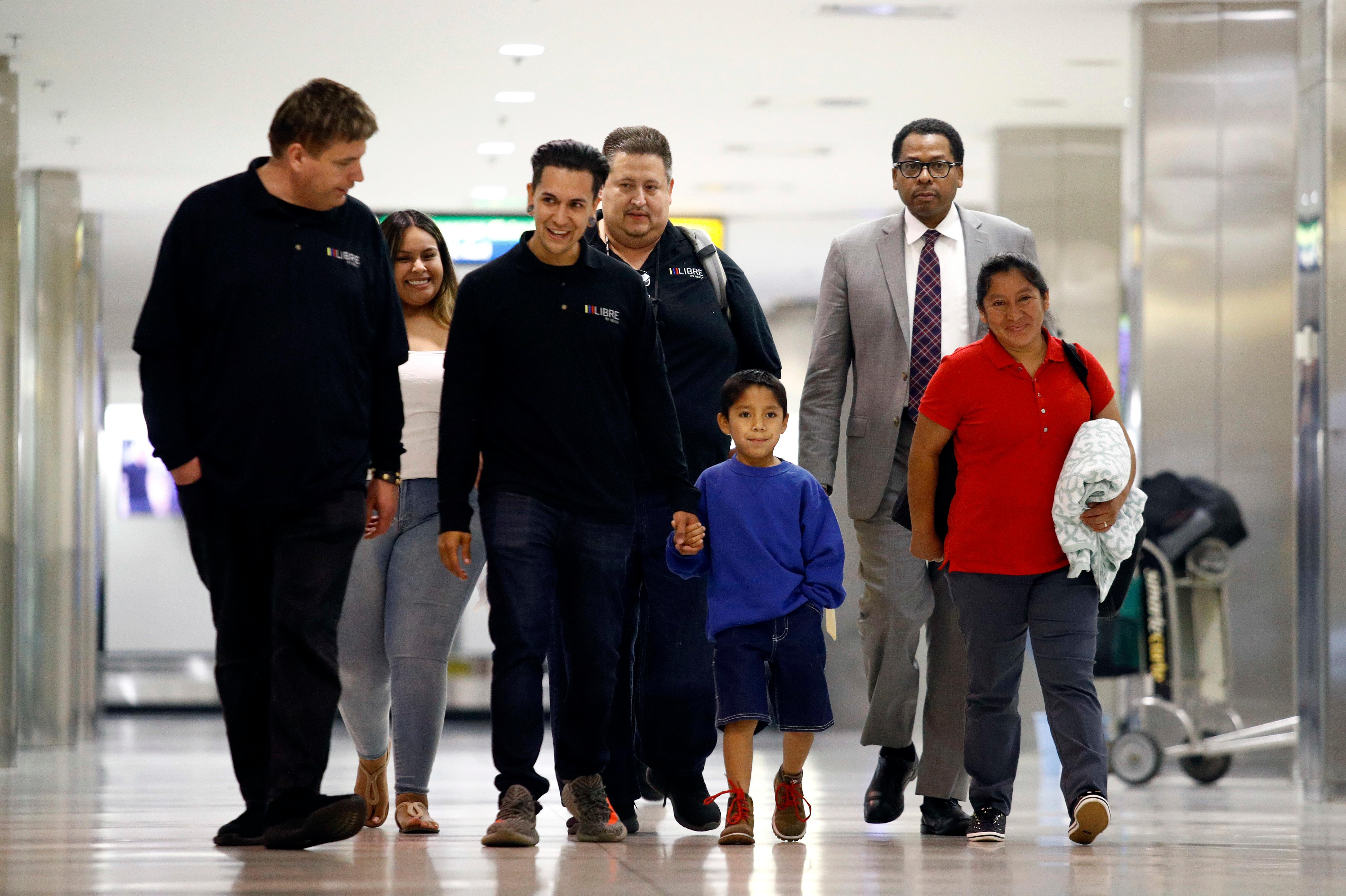 Darwin Micheal Mejia, left, and his mother Beata Mariana de Jesus Mejia-Mejia are escorted to a news conference. (AP Photo/Patrick Semansky)<p></p>