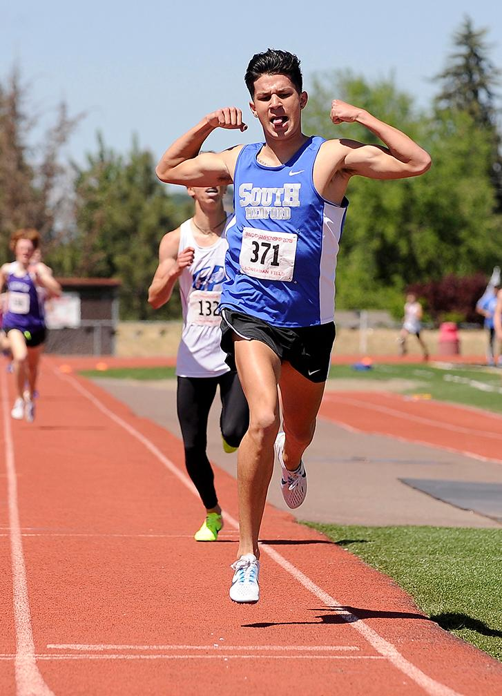 Andy Atkinson / Mail TribuneSouth Medford's Luke Ramirez (371) celebrates crossing the line winning the 1,500-meter run at the SWC Championships meet at North Medford High School Saturday.