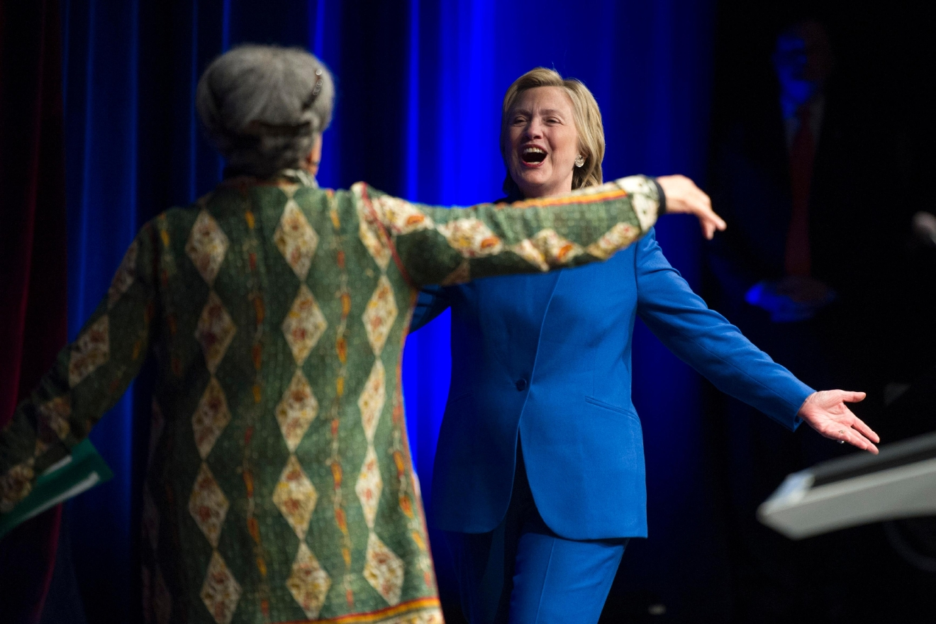 Hillary Clinton is welcomed onstage by Marian Wright Edelman, president and founder of the Children's Defense Fund, before addressing the group's Beat the Odds celebration at the Newseum in Washington, Wednesday, Nov. 16, 2016. (AP Photo/Cliff Owen)