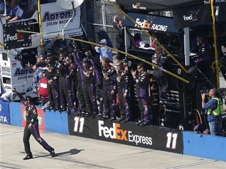 Denny Hamlin's crew cheers as Hamilin wins the NASCAR Aaron's 499 Sprint Cup series auto race at Talladega Superspeedway, Sunday, May 4, 2014, in Talladega, Ala. (AP Photo/John Bazemore)