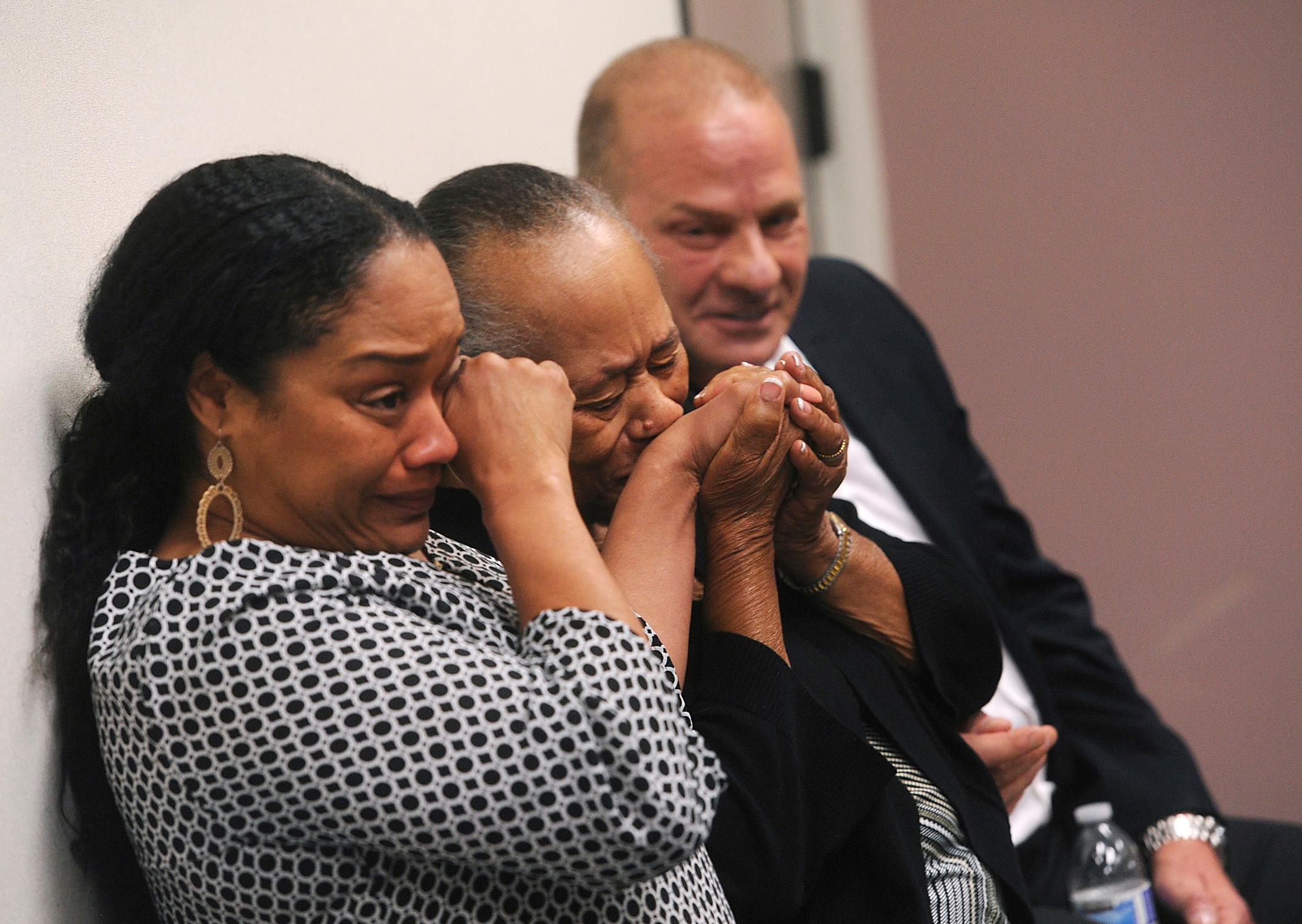 CORRECTS SPELLING FROM ARIELLE TO ARNELLE - O.J. Simpson's sister Shirley Baker, center, daughter Arnelle Simpson, left, and friend Tom Scotto react after O.J. Simpson was granted parole at Lovelock Correctional Center in Lovelock, Nev., on Thursday, July 20, 2017.  Simpson was convicted in 2008 of enlisting some men he barely knew, including two who had guns, to retrieve from two sports collectibles sellers some items that Simpson said were stolen from him a decade earlier.   (Jason Bean/The Reno Gazette-Journal via AP, Pool)