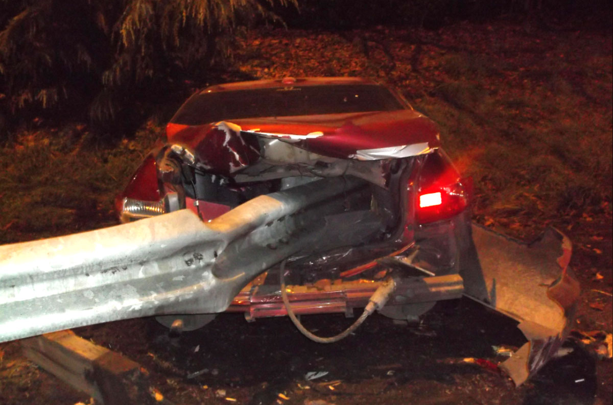 Car crashes as occupants take turning pulling the emergency brake. Police arrested two men for reckless driving and driving under the influence.Photo credit: Springfield Police Department, Springfield, Oregon.