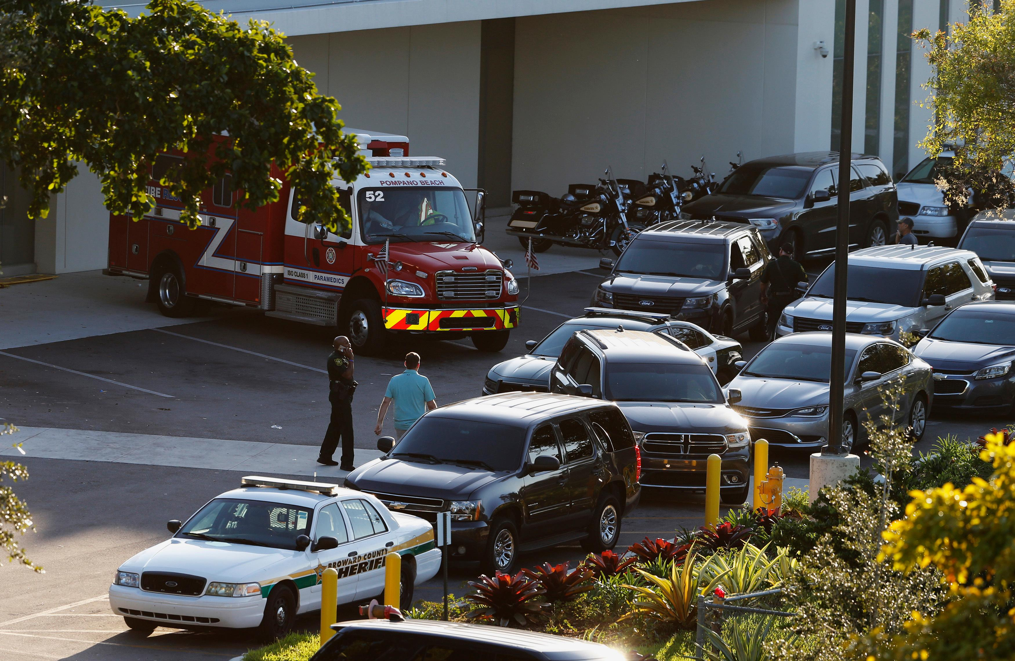 Police and rescue vehicles are shown outside Broward Health North hospital, Wednesday, Feb. 14, 2018, in Deerfield Beach, Fla. A shooter opened fire at a Florida high school Wednesday, killing people, sending students running out into the streets and SWAT team members swarming in before authorities took the shooter into custody. (AP Photo/Joe Skipper)