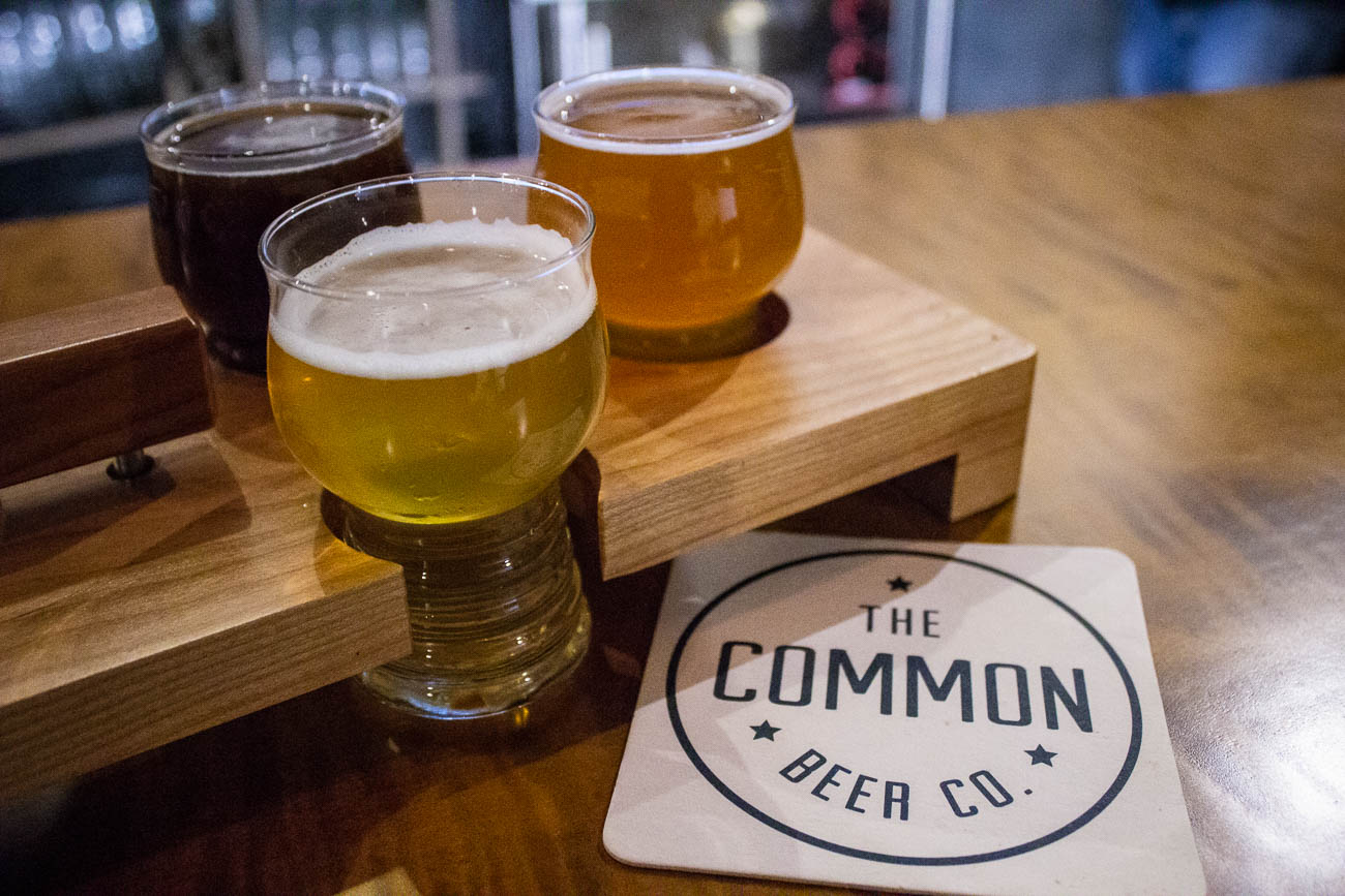 Even the woodwork in Common Beer Company is local. A Lebanon business called Benner's Woodworking created the beer flights, the bar top, and the beer tap handles in the bar. / Image: Katie Robinson, Cincinnati Refined // Published: 1.4.19