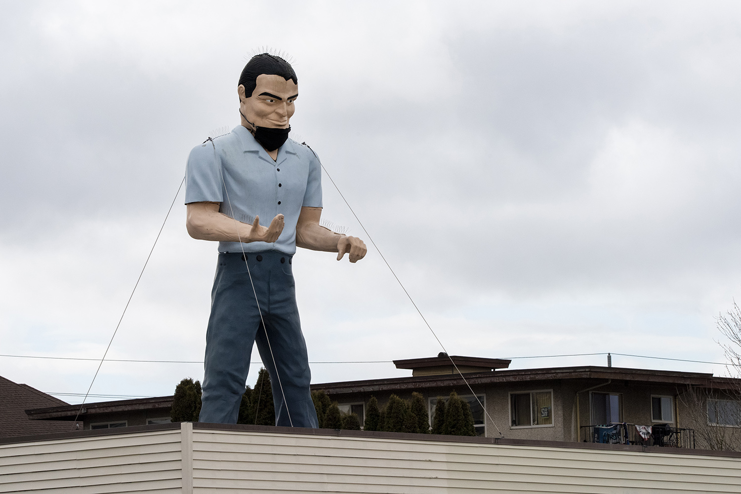 The 20-foot fiberglass structure has been peering over the city since 1983 when Stevedoring Services of America positioned the gigantic man on the roof. (Rachael Jones / Seattle Refined)