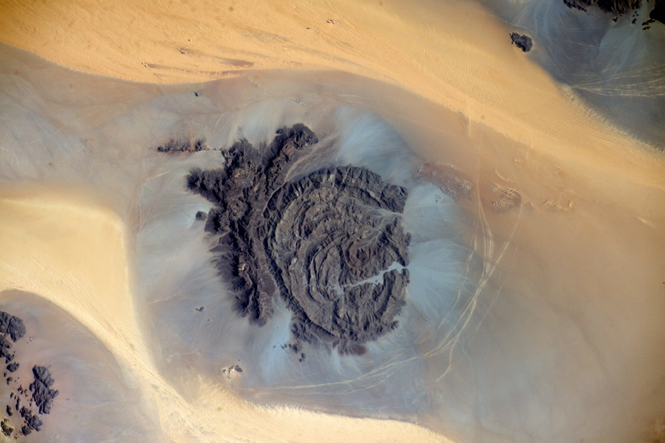 Africa is full of treasures for the eyes. A beautiful rock formation in the desert of Chad (Photo & Caption: Thomas Pesquet // NASA)