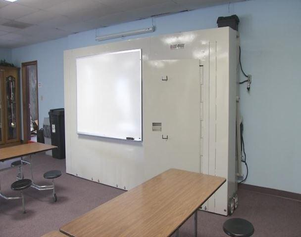 Folded up, the Hide-Away Shelter only sticks out 17 inches from the wall and can be used for the classroom wipe board to make the most of limited class space.