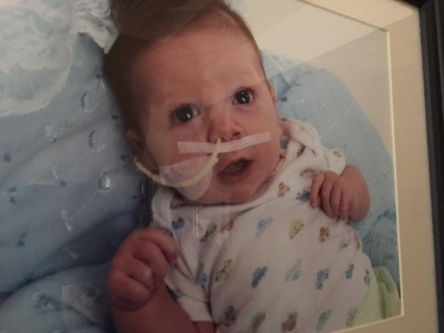 Davis, is now 6, this picture of him as an infant was just the beginning of his difficult journey through seven surgeries. He was born with a congenital heart defect. (Photo credit: Jodi Allen)<p></p>