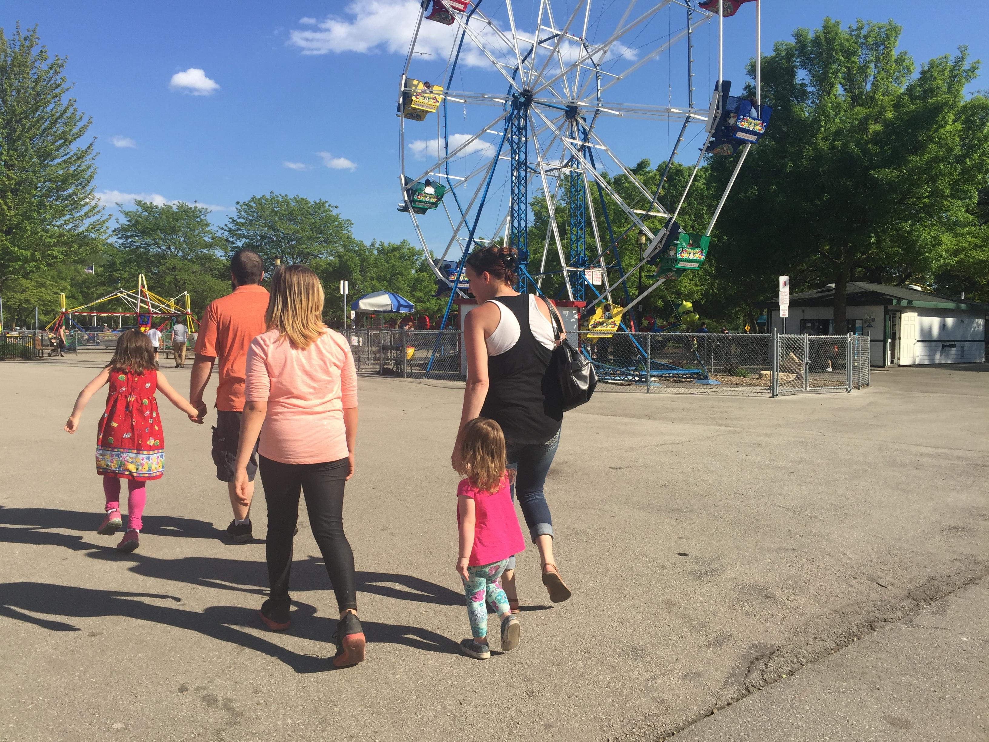 A family walks near the ferris wheel at Bay Beach on Thursday, June 1, 2017. (WLUK/Gabrielle Mays)