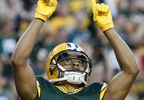 Green Bay Packers' Trevor Davis reacts after running back a punt for a touchdown during the first half of a preseason game against the Philadelphia Eagles Thursday, Aug. 10, 2017, in Green Bay.