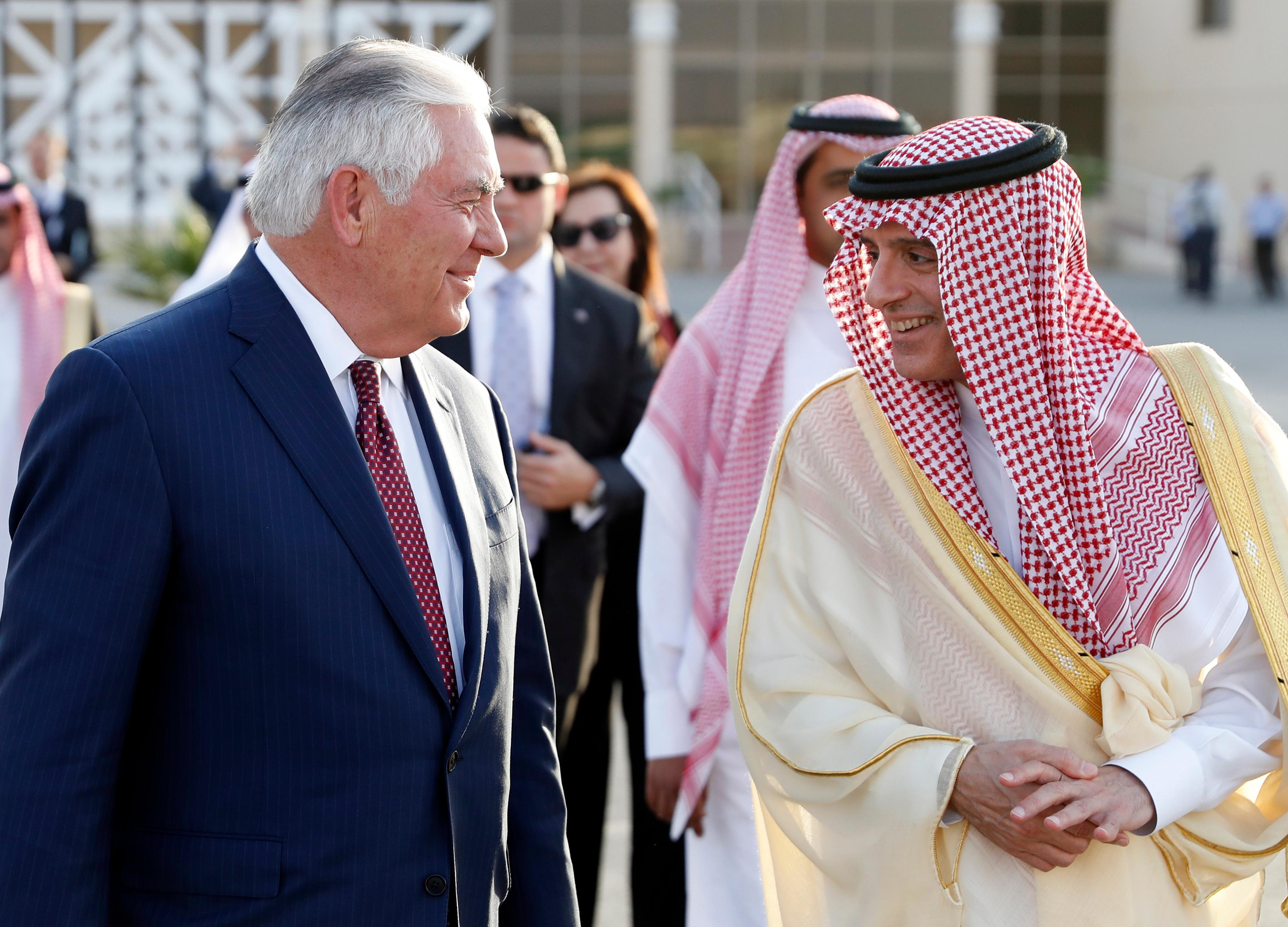 Secretary of State Rex Tillerson speaks with Saudi Foreign Minister Adel Ahmed Al-Jubeir after a press availability as TIllerson walks to his plane, Sunday, Oct. 22, 2017, in Riyadh, Saudi Arabia. (AP Photo/Alex Brandon, Pool)