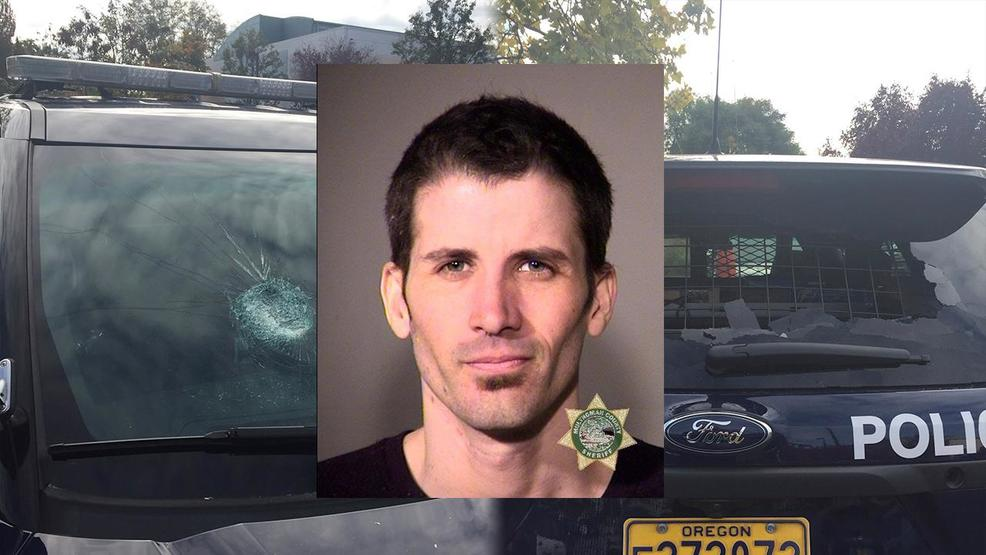 Man accused of throwing large rocks at Portland police cruisers