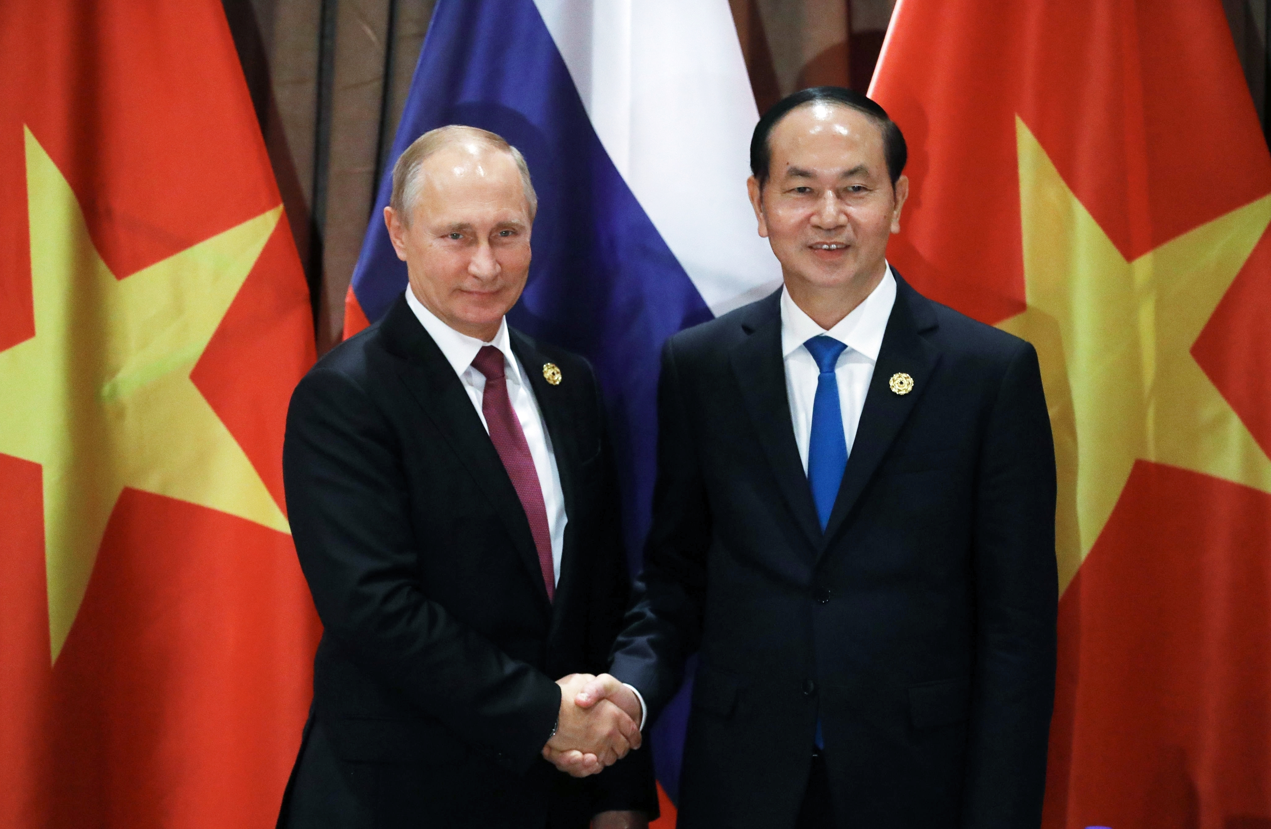 Russia's President Vladimir Putin, left, and Vietnam's President Tran Dai Quang shake hands during their meeting at the APEC Business Advisory Council dialogue in Danang, Vietnam Friday, Nov. 10, 2017. (Mikhail Klimentyev, Sputnik, Kremlin Pool Photo via AP)