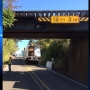 """13 ft. 6 in. > 12 ft. 3 in."" Truck stuck overnight at railroad underpass"