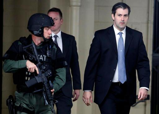 FILE- In this Monday, Dec. 5, 2016 file photo, Michael Slager, at right, walks from the Charleston County Courthouse under the protection from the Charleston County Sheriff's Department after a mistrial was declared for his trial in Charleston, S.C. (AP Photo/Mic Smith, File)