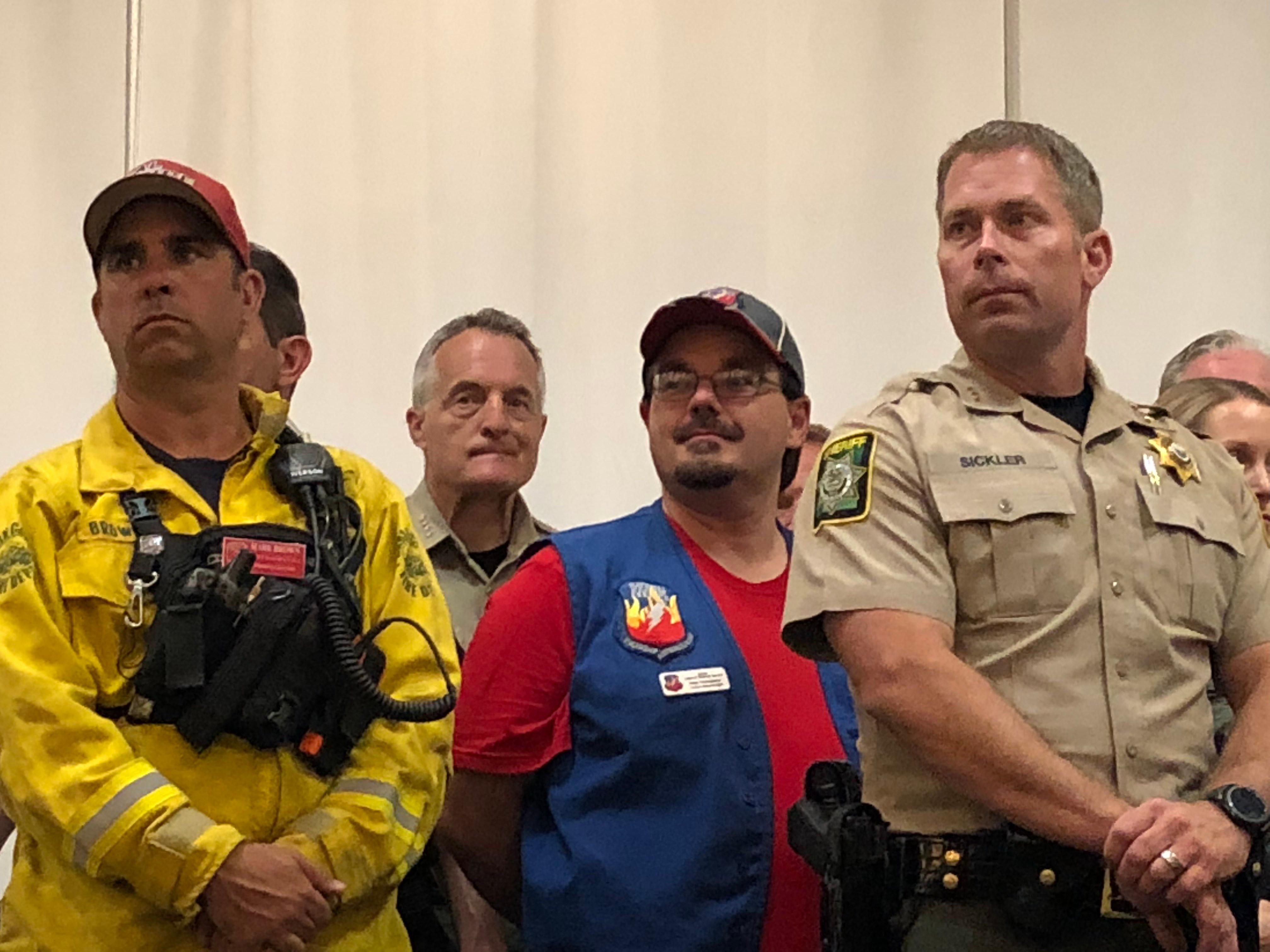 From left, CalFire incident commander Mark Brown, meteorologist Rich Thompson of NOAA and Jackson Photo by John DarlingCounty Sheriff Nate Sickler stand by to answer questions from the public at a meeting Monday in Ashland.