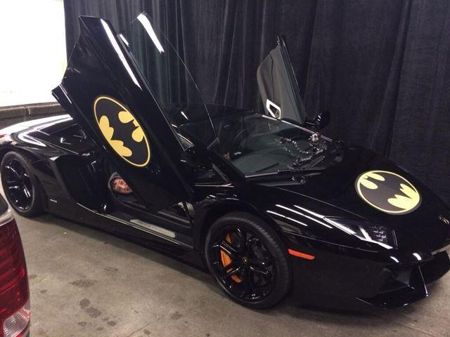 Batkid is riding around San Francisco is Lamborghinis with Batman decals.
