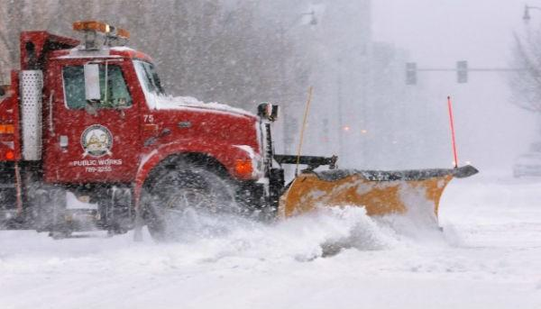 A city snowplow clears the street in an almost deserted downtown Springfield on January 5.