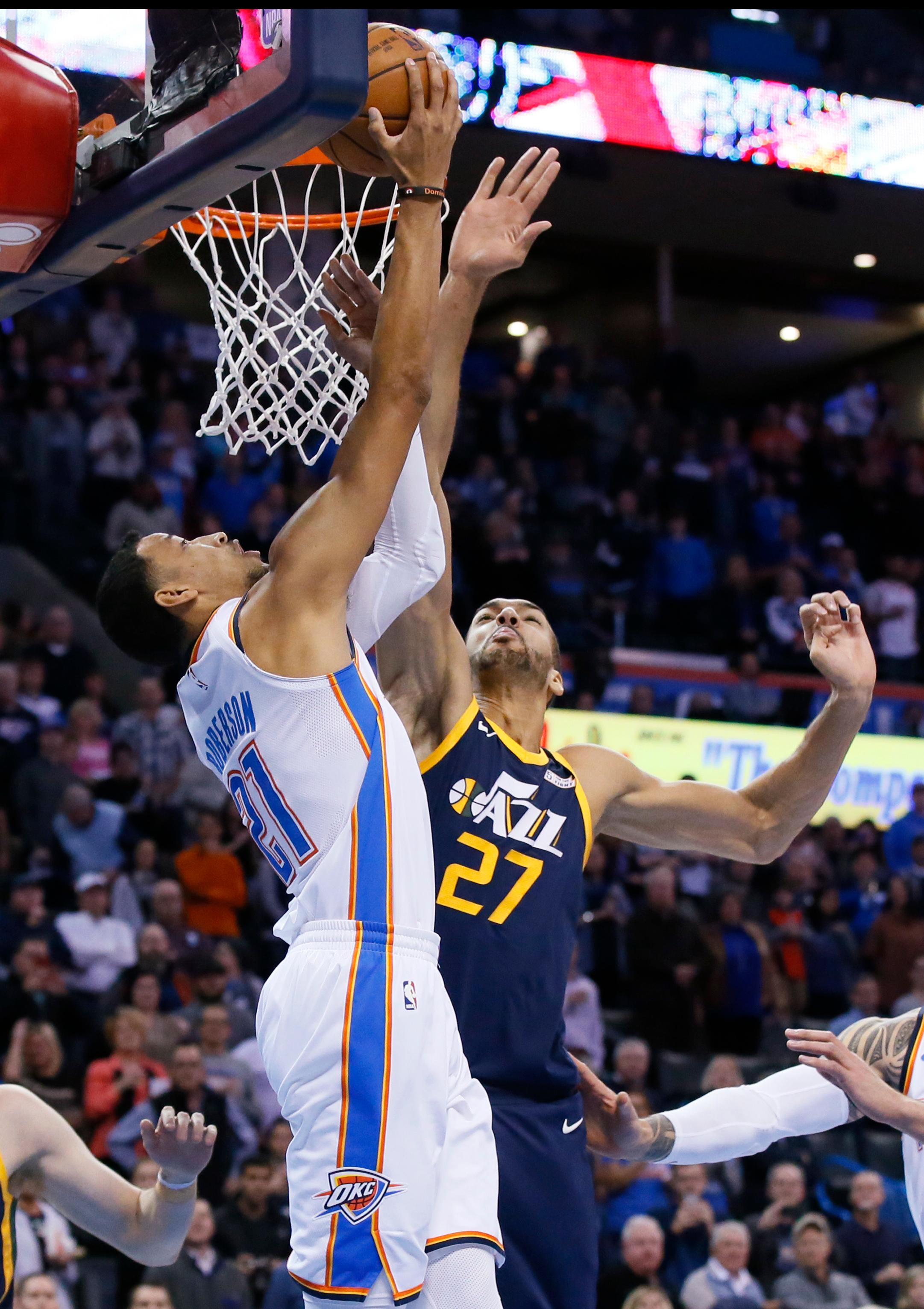 Oklahoma City Thunder guard Andre Roberson (21) shoots in front of Utah Jazz center Rudy Gobert (27) in the first quarter of an NBA basketball game in Oklahoma City, Tuesday, Dec. 5, 2017. (AP Photo/Sue Ogrocki)