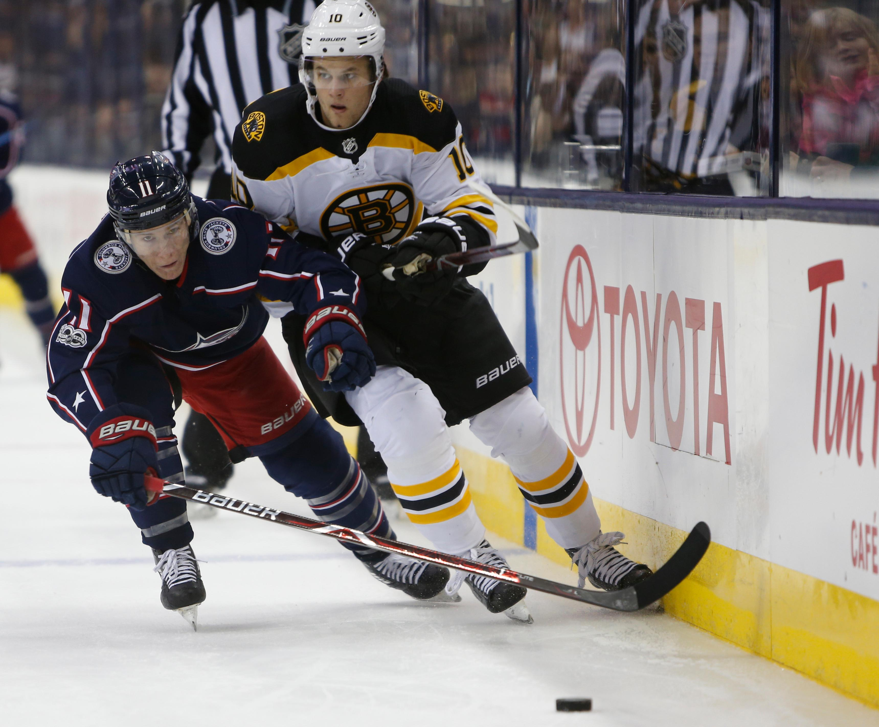 Columbus Blue Jackets' Matt Calvert, left, carries the puck past Boston Bruins' Anders Bjork, right, during the second period of an NHL hockey game Monday, Oct. 30, 2017, in Columbus, Ohio. (AP Photo/Jay LaPrete)