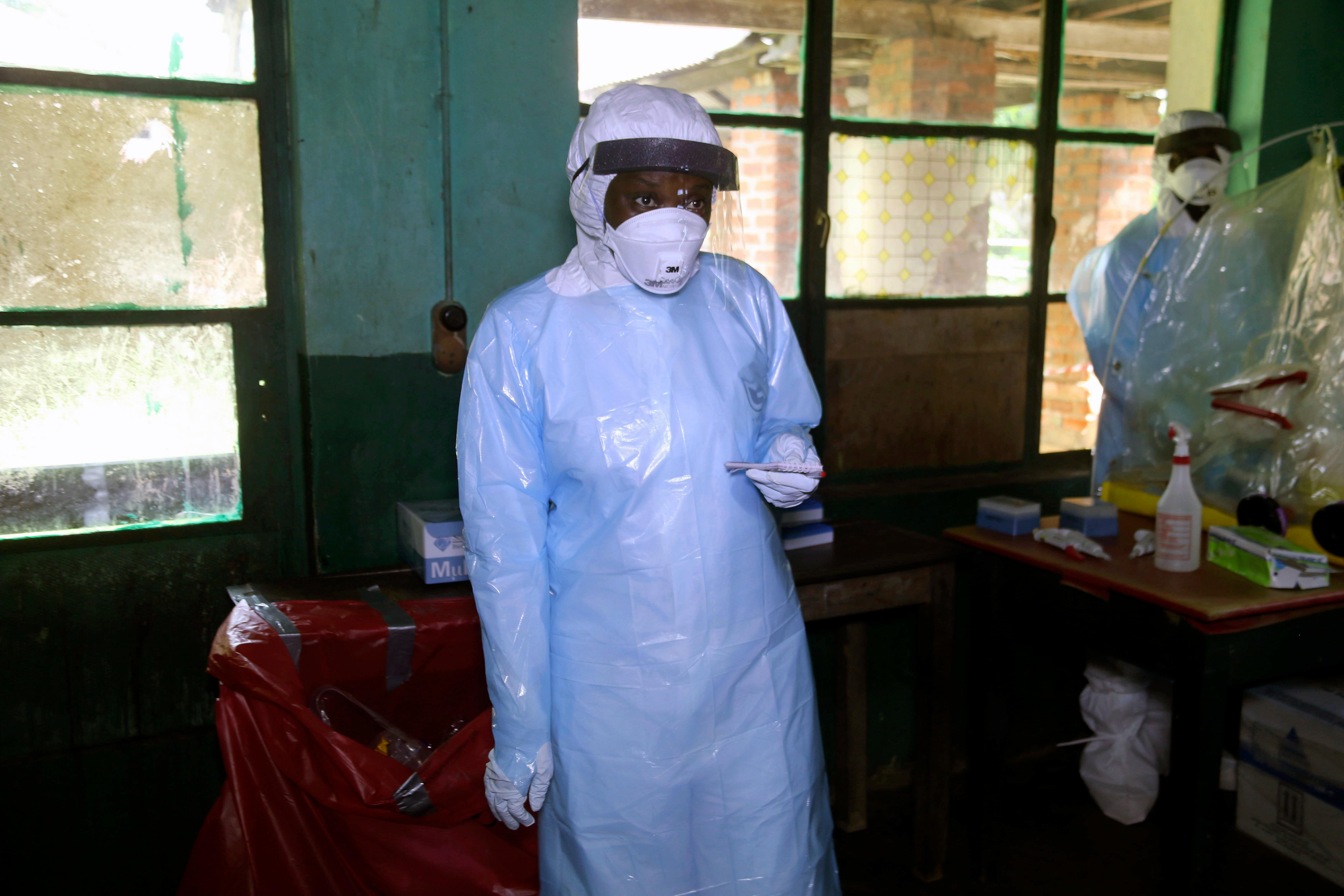 In this photo taken on Sunday, May 13, 2018, a health care worker wears virus protective gear at a treatment center in Bikoro Democratic Republic of Congo. Congo's latest Ebola outbreak has spread to a city of more than 1 million people, a worrying shift as the deadly virus risks traveling more easily in densely populated areas. Two suspected cases of hemorrhagic fever were reported in the Wangata health zones that include Mbandaka, the capital of northwestern Equateur province. The city is about 150 kilometers (93 miles) from Bikoro, the rural area where the outbreak was announced last week, said Congo's Health Minister Oly Ilunga. (AP Photo/John Bompengo)